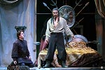 Onstage as Uldino, kneeling